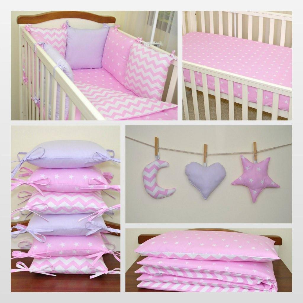 Подушечка - бортик для дитячого ліжечка в ніжних тонах