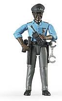 BRUDER  Фигурка полицейского с аксессуарами  (60051)