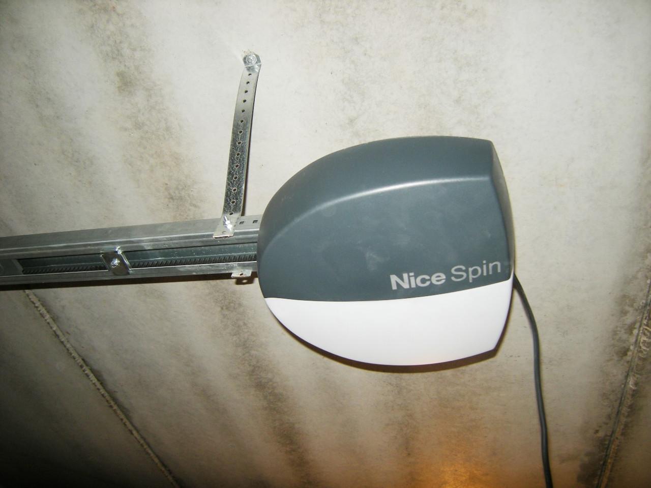 Электропривод для секционных ворот SPIN6031, система BlueBUS.