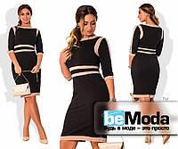 Деловое женское платье больших размеров приталенного кроя с оригинальными контрастными вставками черное