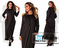 Стильное женское платье удлиненного свободного фасона из качественного трикотажа с декором из блестящих молний по краю низа черное