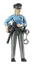 BRUDER  Фигурка женщины -  полицейского с аксессуарами  (60430)