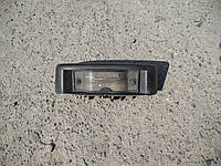 Фонарь подсветки номера на Renault Trafic, Opel Vivaro, Nissan Primastar