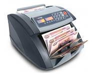 Лічильники банкнот і пристрої для перевірки грошей