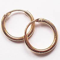 Серьги кольца золотистые (диаметр 12 мм) для пирсинга ушей.