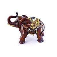 Красивая и роскошная статуэтка слона коричневого цвета из полистоуна с хоботом к верху.