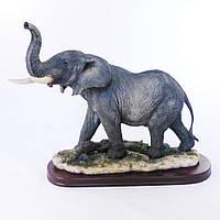 Интересная большая напольная фигура слона из полистоуна.