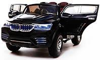 Детский электромобиль на надувных колесах BMW X4 черный с кожаным сиденьем