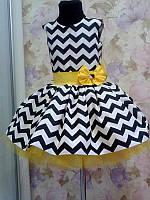 Оригинальное нарядное платье на девочку с пышной юбкой и бантом на поясе
