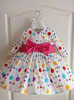Праздничное детское платье с пышным низом и ярким веселым принтом