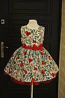 Яркое нарядное детское платье с пышным низом и цветочным принтом