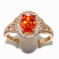 Кольцо фирмы Xuping.Камни: белые фианиты и  ярко-оранжевый циркон.Есть 16 р. 17 р. 18 р.