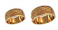 Золотые обручальные кольца 585* пробы с сюжетом на шероховатой поверхности