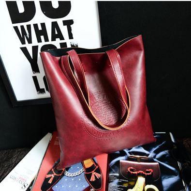 Бардовая женская сумка