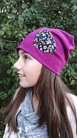 Модная шапочка фиолетового цвета для девочки