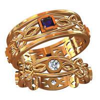 Небольшие эксклюзивные золотые обручальные кольца 585* пробы с камнями