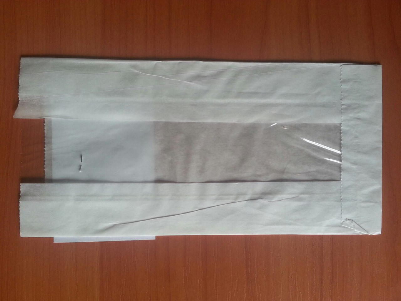 Бумажный пакет с прозрачной вставкой 210х100х50/40 мм 69