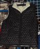 Тепла жилетка на овчині чорного кольору на блискавці