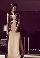 Изысканное длинное платье с сеткой по бокам и ажуром