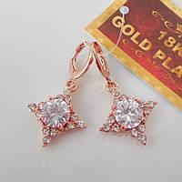 Серьги звездочка розовое золото 18К позолота  белый цирконий