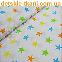 Ткань хлопковая с оранжево-салатовыми остроконечными звёздами № 442