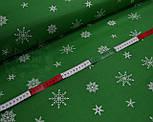 Ткань хлопковая с редкими снежинками на зелёном фоне № 447, фото 2