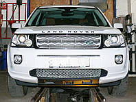 Декоративно-защитная сетка радиатора Land Rover Freelander 2 фальшрадиаторная решетка, бампер