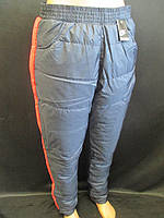 Женские теплые штаны с яркими вставками по бокам.