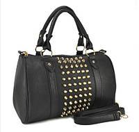 Стильная женская сумка с шипами.