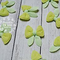Декор для швейных изделий: бантики салатового цвета.
