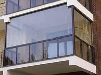 Чи варто використовувати безрамне скління для балкона?