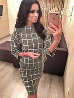 Женский стильный юбочный костюм в клетку