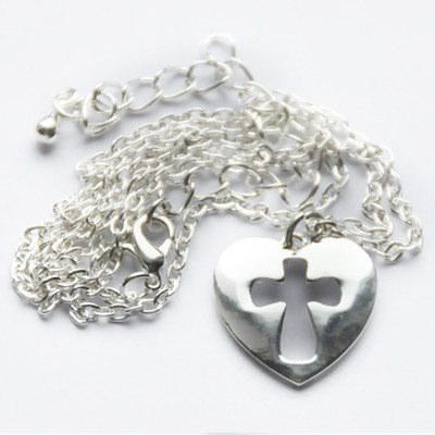 Кулон. Сердце с высеченным  крестом.