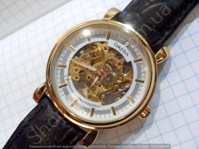 02a36deb7bbcf2 Мужские часы Omega 2060 114413 золотистые на черном ремешке механические с  автоподзаводом скелетоны.