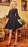 Черное платье с пышной юбкой