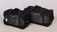 Комплект дорожных сумок на колесиках в черном цвете