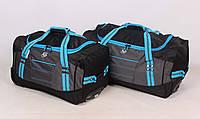 Комплект дорожных сумок на колесиках в сером цвете