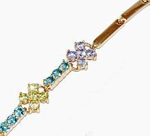 Браслет фирмы Хuping,с разноцветными фианитами, позолота . Длинна регулируется от 17,5 до 19,5 см. Ширина 7 мм