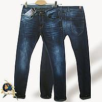 Джинсы мужские молодёжные узкого кроя Or.Jean синего цвета с оливковым отворотом.