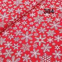 """Ткань хлопковая """"Снежинки на красном фоне""""№304"""