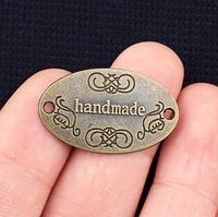 "Бирка  ""Hand made"",  овал 3х2 см, античная бронза"