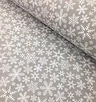 Новогодняя ткань польская снежинки на сером