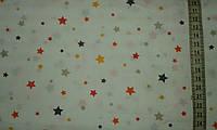 Ткань с мелкими разноцветными желтыми и оранжевыми звездочками, фото 1