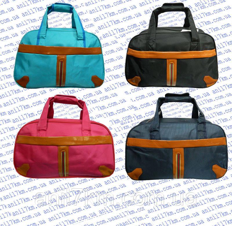 Дорожня сумка-саквояж середнього розміру