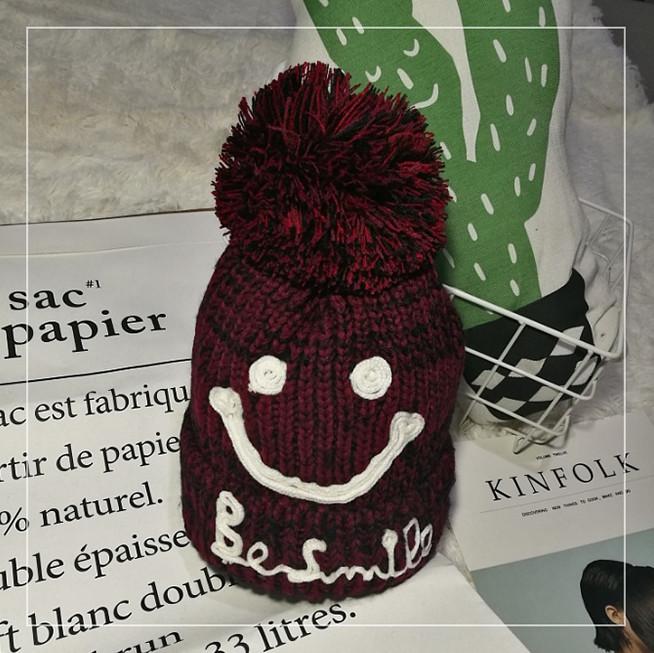 Женская теплая вязаная шапка с бубоном (помпоном) Be Smile бордовая