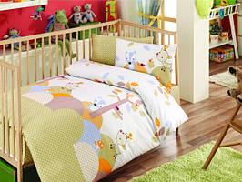 Комплекти постільної білизни в дитяче ліжечко