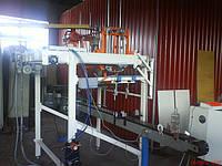 Автоматический толкатель стеклотары на накопительный стол паллетоупаковщика.