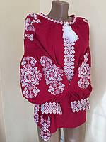 Жіноча вишиванка червого кольору на домотканому полотні