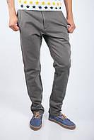Удобные мужские брюки оригинального свободного кроя с карманами по бокам оливковые