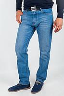 Эффектные мужские джинсы зауженного кроя из качественного коттона без потертостей синие